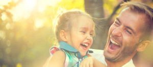 laughing-dad-girl-AdobeStock_119589773-300x131.jpeg