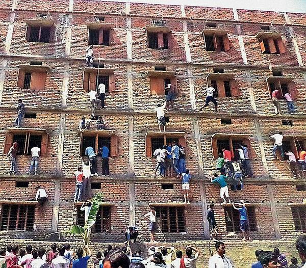Parents often climb the walls, but not usually to help kids cheat in school