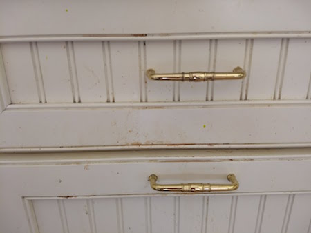 greasy cabinet drawers