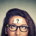 Woman with a question mark post-it on her forehead
