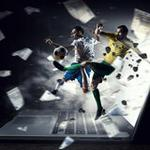 A footballer and cash explode from a laptop screen