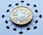 A pound coin with a coronavirus style circle around it