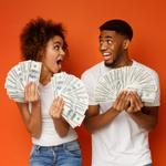 A couple hold bunches of cash