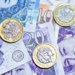 Twenty pound notes and pound coins