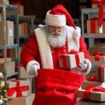 Santa packs his bag in a post room