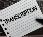 A notepad with the word Transcription on it