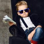 A boy holds a wad of cash