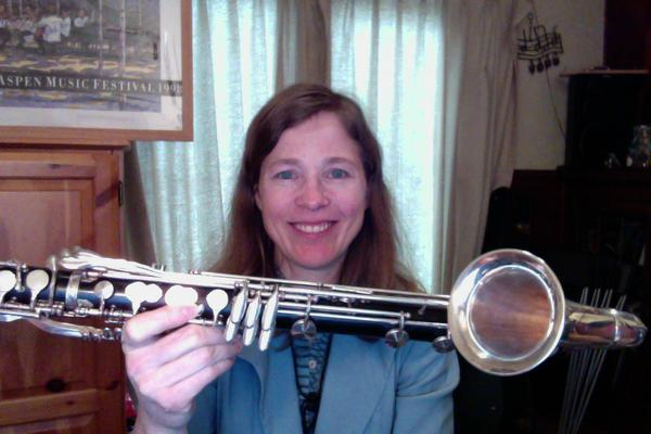 MIchelle Anderson holds up a basset horn